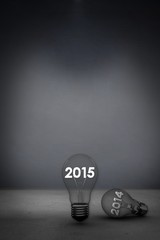 Composite image of 2014 and 2015 in light bulb