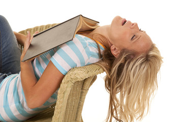 woman asleep reading a book