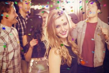 Composite image of stylish blonde smiling at camera