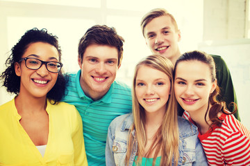 group of smiling people at school or home