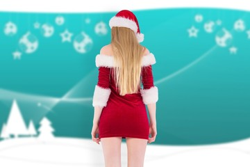 Composite image of festive blonde standing rear view