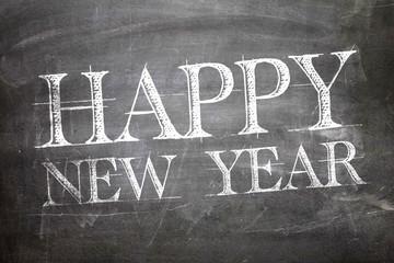 Happy New Year written on blackboard