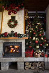 Christmas tree near burning fireplace decorated with christmas w