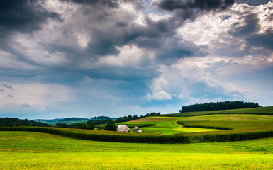 Storm clouds over rolling hills and farm fields in Southern York