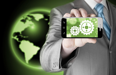 businessman show gear on smartphone to success concept