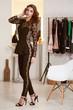 Baeutiful sexy woman skiny body shape in black evening suit