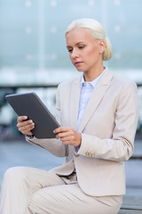 businesswoman working with tablet pc outdoors