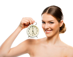 Beautiful woman with clock close up, smiling