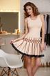 Baeutiful sexy woman in fashion short pink evening dress