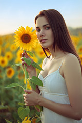 Young woman with sunflower