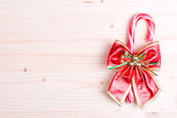 Christmas candy cane with bow on a blackboard bright colors
