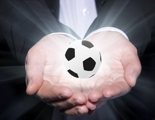 Football manager hold ball
