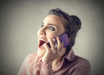 Girl screaming at the phone