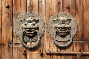 Rusty old Chinese door tiger knob