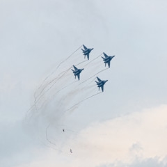 Four military jet planes in sky