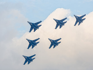 Six war jet planes in sky