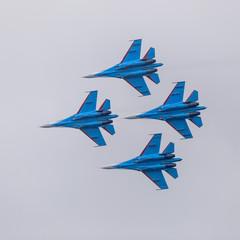Four war jet planes in sky