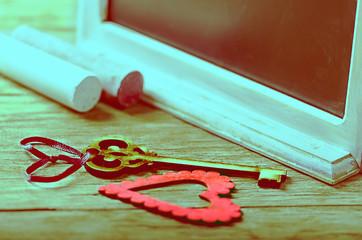 Saint Valentines decoration: heart, key, black board and chalk