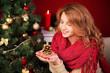 Beautiful woman against Christmas tree