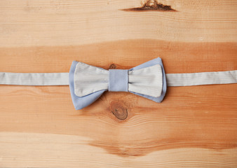bow tie on wooden background