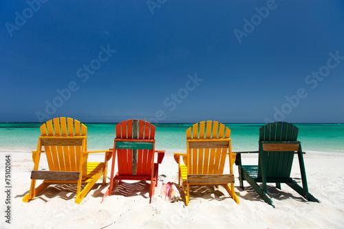 Fotobehang Caraïben Colorful chairs on Caribbean beach