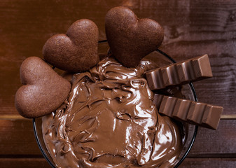 Chocolate cream cocktail with heart-shaped biscuits and chocolat