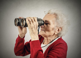 Elderly woman using bisoculars