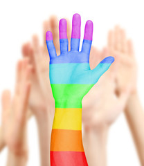 Man's hand painted as the rainbow flag on other hands