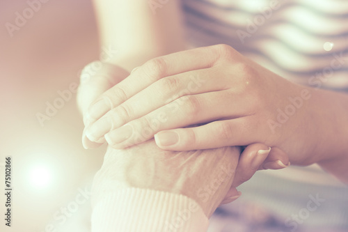 Helping hands, care for the elderly concept - 75102866