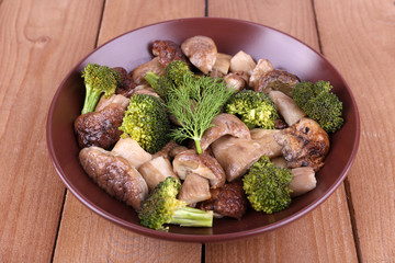 Braised wild mushrooms with vegetables and spices in plate