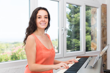 Female musician playing sequencer