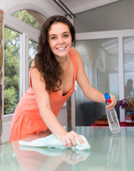 Girl cleaning table