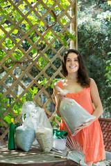 Female with fertilizer at garden