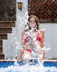 Girl making splash with water