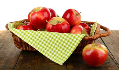 Wicker basket of red apples with napkin