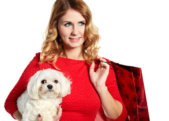 beautiful young woman and a sweet little white dog. Shopping