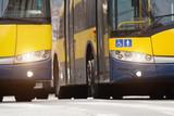 Side by side public transportation - bus.