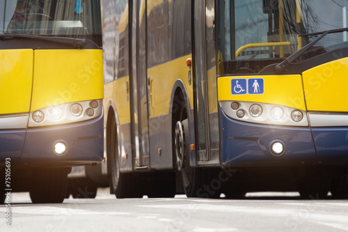 Side by side public transportation - bus.