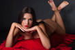 Brunnete topless with thong covered with a red fabric