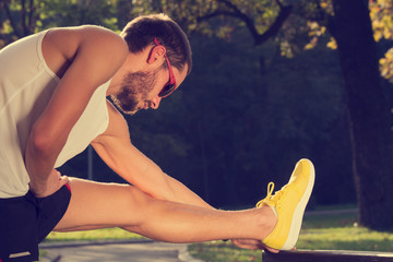 Stretching after jogging/exercise.
