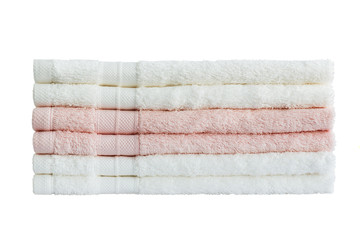 White and pink bath towels in stack. Isolated