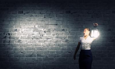 Businesswoman with lantern