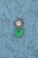 Wooden flower attached in a wooden wall