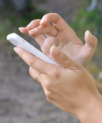 Female hands with the mobile phone