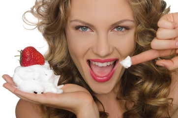 Beautiful woman with strawberries and cream