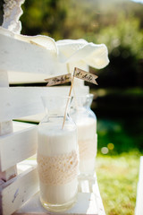 milk in glass bottle with decoration