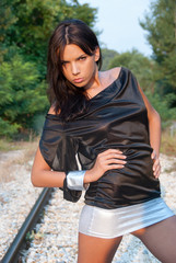 Girl standing on the rails , fashion shooting outdoor