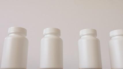 White small bottles on conveyor belt