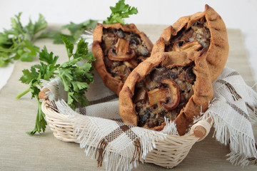 Three rye pies with champignons and onions