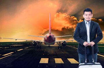 young man and luggage standing against passenger jet plane prepa